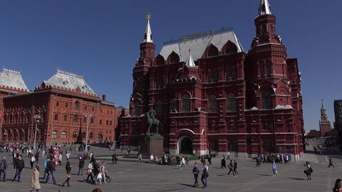 Manezhnaya Square panorama, pan to State Historical Museum, people stroll Footage