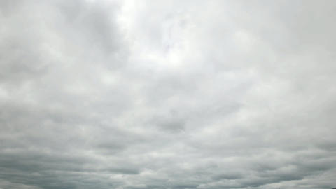 Solid overcast sky rush away, time lapse shot of gray clouds cover whole skies Footage