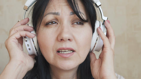 Woman emotionally singing at home Live Action