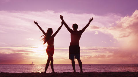 Enjoyment wellness and success - happy couple on beach enjoying sunset Live Action