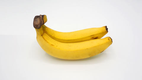 Real two yellow banana from Bangkok Thailand no retouch and white background studio shot and フォト