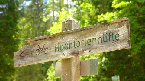 Wooden Direction sign to Hochtorlen hut at Lake Eibsee Bavaria Live Action