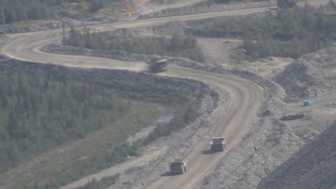 dump trucks for transportation of ore. road to open mountain quarry Live Action