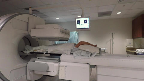 Cancer SPECT image scanner hospital female patient HD 912 Footage