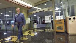 Cancer hospital parking garage husband man enter HD 0895 Footage