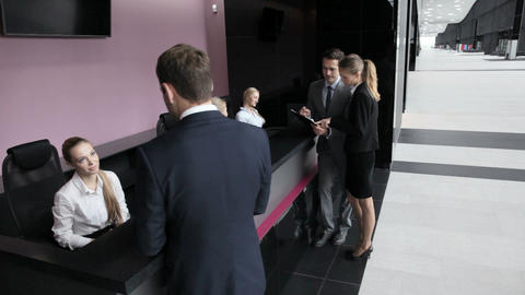 Business people at front desk Live Action