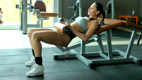 Muscular brunette fitness woman doing exercises in the gym Footage