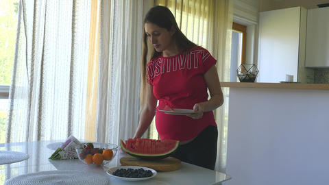 Young pregnant woman healthy eating Live Action