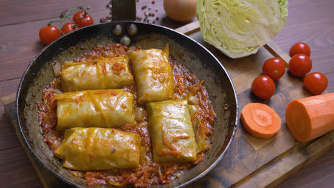 Stuffed cabbage in a pan fried in tomato sauce Live Action