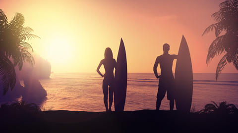 Silhouettes of surfers on a tropical beach at sunset Fotografía