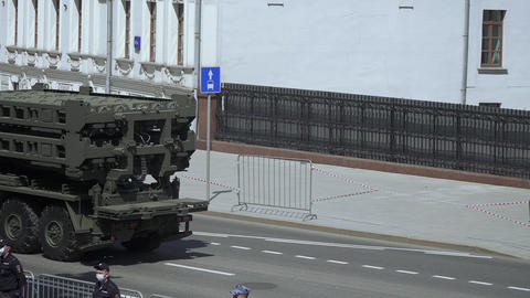 Spectators and military equipment traveling from the parade Live Action