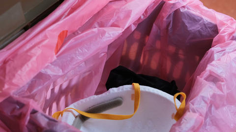 Man trash protective mask and gloves on separate garbage bin,covid19 disease Live Action