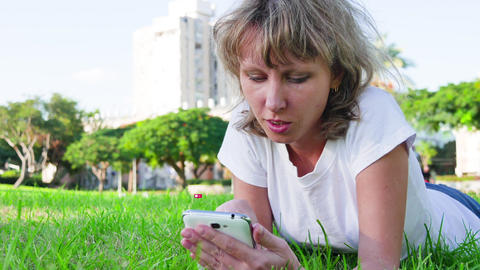 Girl with a smartphone communicates in a social network Live Action