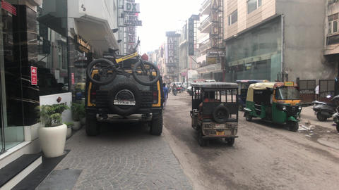 New Delhi, India, November 11, 2019, old town street with transport and tourists Live Action