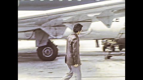 MILAN 1976: People get off the plane in Milan Airport 2 Live Action