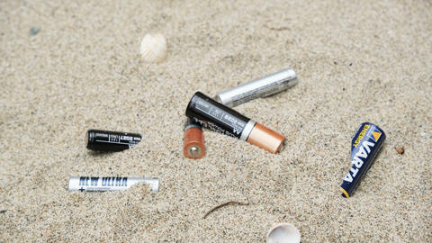 Man collect electronic battery waste on sandy sea coast ecosystem,pollution 4k Live Action