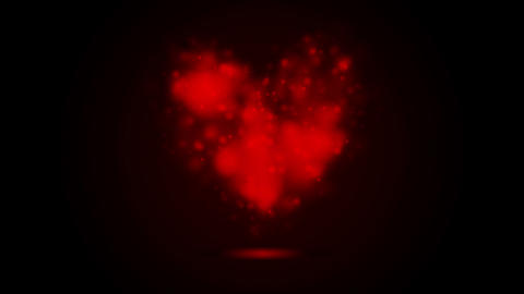 Glowing shiny red heart on black background Animation