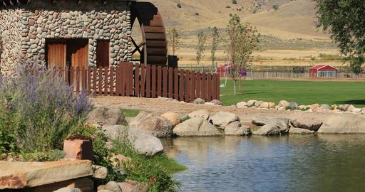 Water wheel in rural park and garden pond DCI 4K 571 Footage