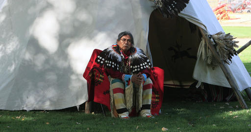 Native American sitting by tipi home DCI 4K 582 Footage