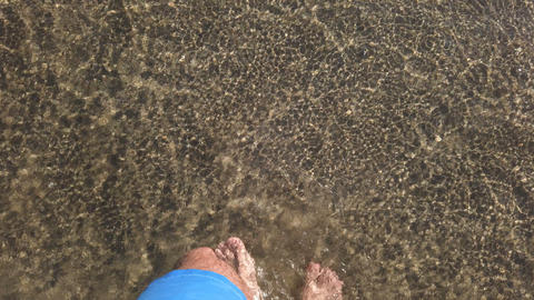 Top view of young man walking on crystal sea water,summer lifestyle,freedom 4k Live Action