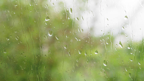 weather forecast, video screensavers concept - close-up rain drops flow down Live Action