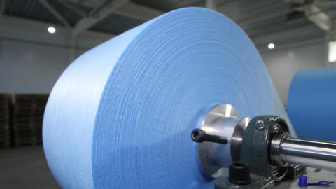 motion past turning roll of textile for protective masks Live Action