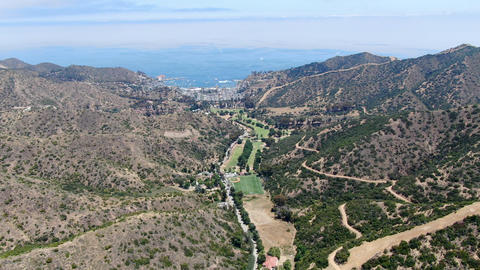 Aerial view of Santa Catalina Island mountains and trails with ocean on the Live Action