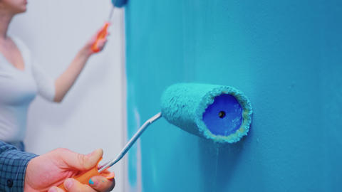 Roller brush on wall Live Action