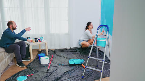 Couple redecorating apartment Live Action