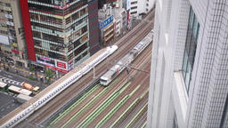 Trains passing on elevated track, Tokyo, Japan Footage