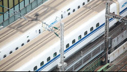 Above view of bullet trains on a railtrack, Tokyo, Japan Footage