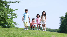 Japanese kids jumping on a hill in a park, Tokyo, Japan Footage