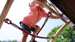 Japanese young boy playing at playground in a park, Tokyo, Japan Footage