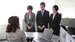 Japanese new employees being told off by their boss in the office Footage