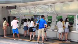 People buying train tickets at JR Harajuku Station vending machines, Tokyo, Japa Footage
