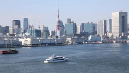 Boats cruising at Tokyo Bay and view of Tokyo cityscape from Rainbow Bridge, Tok Footage