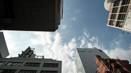 Time lapse bottom view of clouds over office buildings in Ginza, Tokyo, Japan Footage