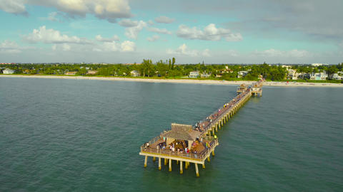 People walk on a pier in Naples, Florida, 4k Live Action