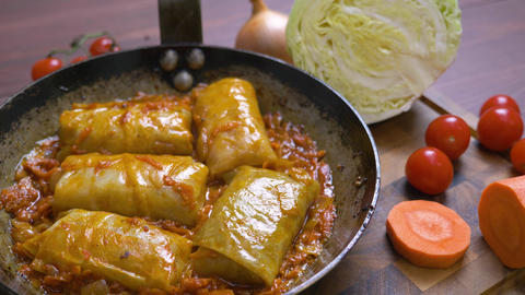 Tomato sauce boils in a pan with cabbage rolls Live Action
