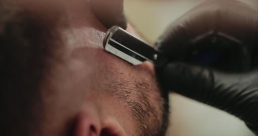Shaving with a dangerous razor. Close-up Live Action