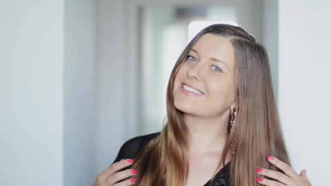 Portrait of a young woman with long healthy brown hair, haircare routine for Live Action