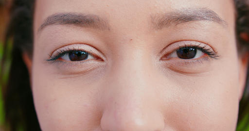 Asian Lady's Eyes Blinking Outdoors Live Action