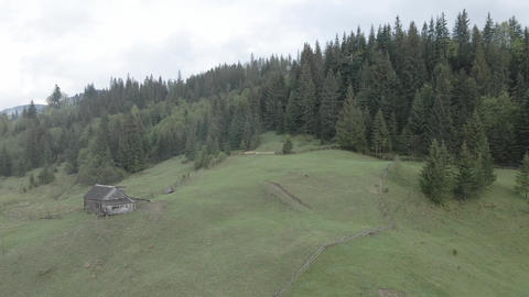 Ukraine, Carpathian Mountains: House in the mountains Aerial. Flat, gray Live Action