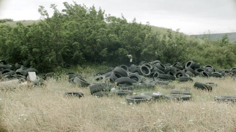 Tires in nature, landfill, irresponsibility of people, environmental disaster Live Action