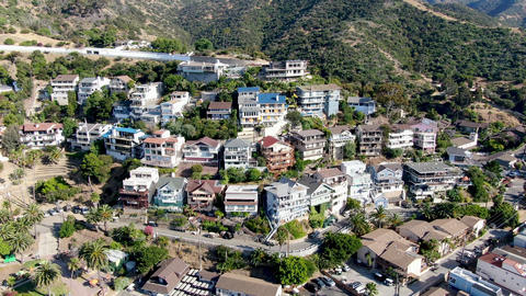 Aerial view of Avalon downtown with their houses on the cliff in Santa Catalina Live Action