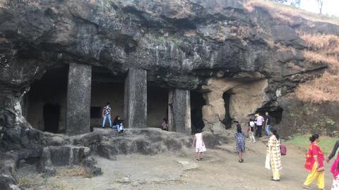 Mumbai, India - November 10, 2019: Elephanta Caves tourists inspect historic Live Action
