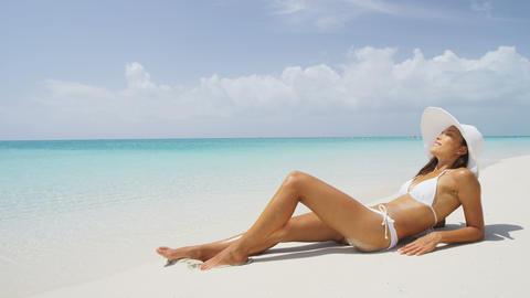 Sexy beach bikini body woman relaxing sun tanning Live Action