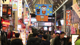 Osaka, JP - January 24, 2015: Pedestrians walking around the Dotonbori shopping  Footage