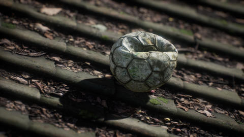 old soccer ball on the roof of a house Live Action
