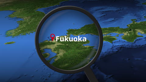 Magnifying glass finds Fukuoka city on the map, 3d rendering Photo